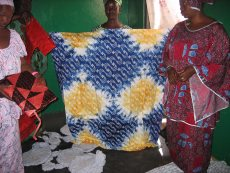 Gambian ladies showing their crafts