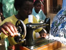 Gambian lady sewing