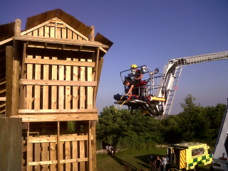 Arial rescue platform rescuing girl from playhouse