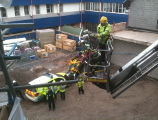 A casualty is rescued using a hydraulic platform