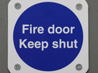 close up of fire door sign
