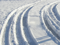 Car tyre tracks in the snow