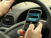 Using a mobile phone at the wheel
